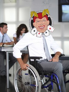 Businessman in wheelchair in the office