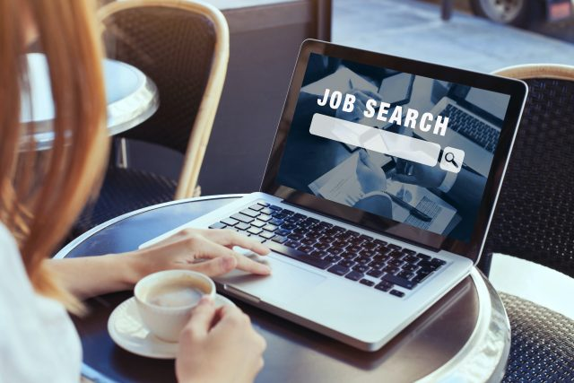 woman looking at online website to search a new job